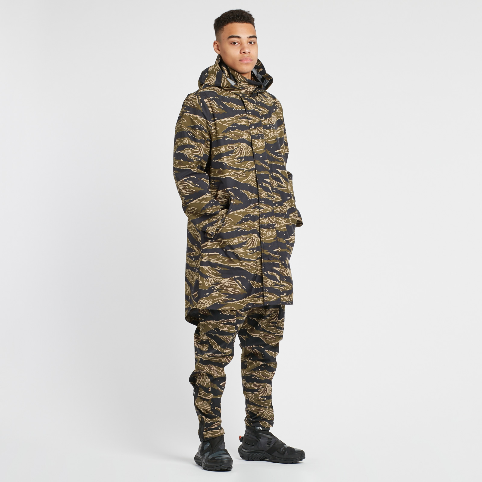 53b32a0983 The NikeLab Essentials Tiger Camo Parka Men's Jacket offers striking visual  style and protection thanks to a water-repellent 3-layer fabric with taped  seams ...