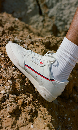 Foot of a men using an adidas Continental 80 sneaker in white