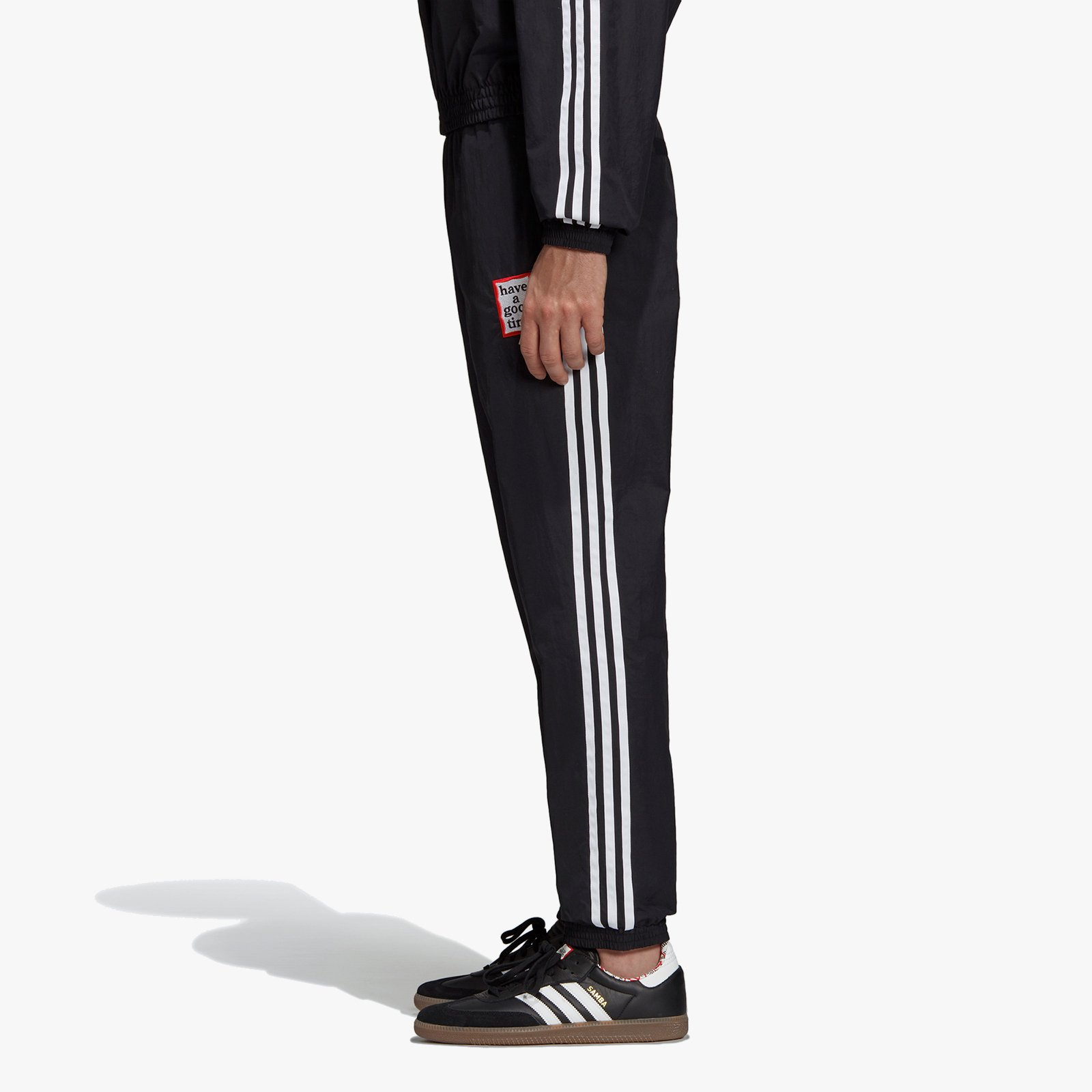 separation shoes 4b7d4 6743f ... adidas Consortium Reversible Track Pants x Have A Good Time ...