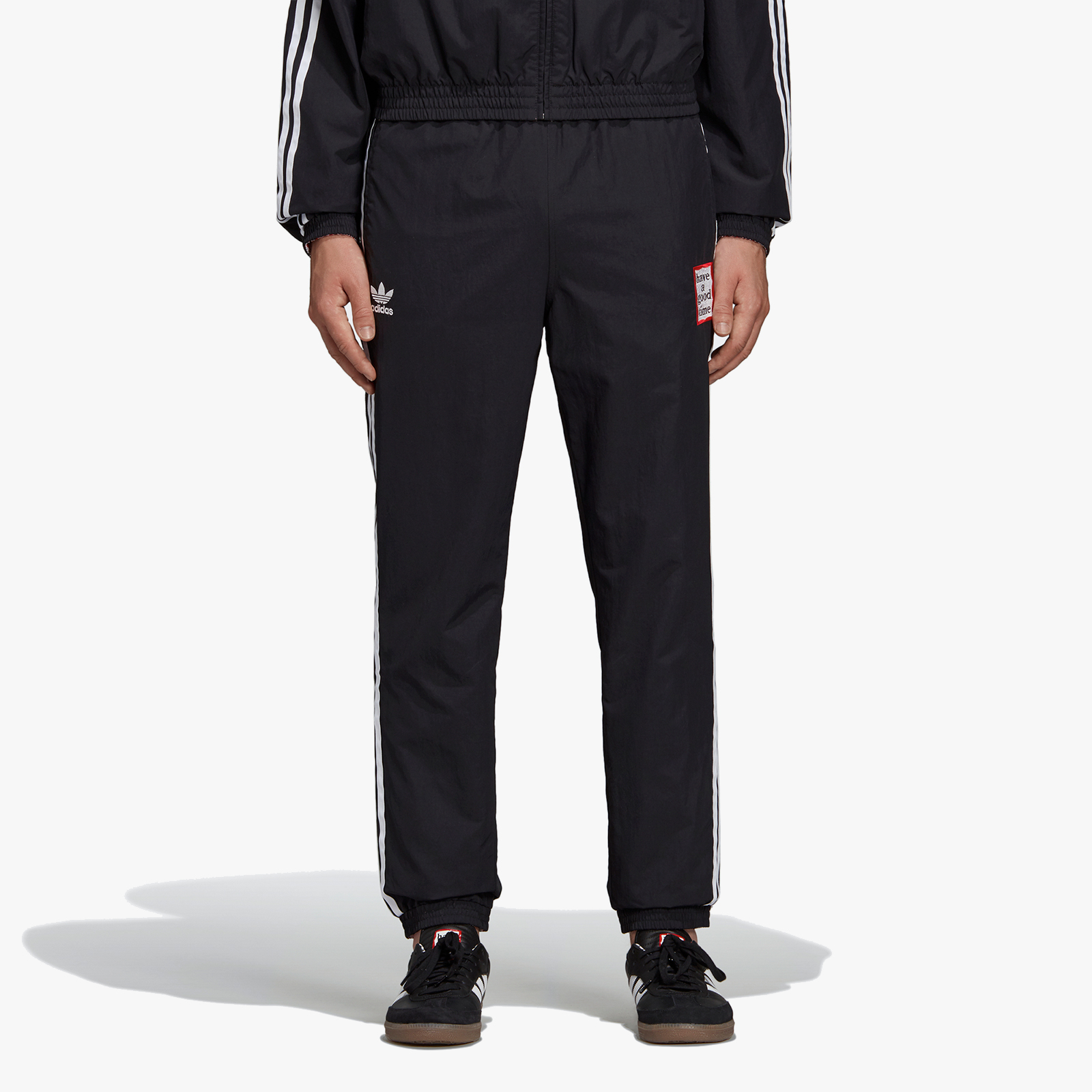 official photos f5a7b a8d18 adidas Consortium Reversible Track Pants x Have A Good Time