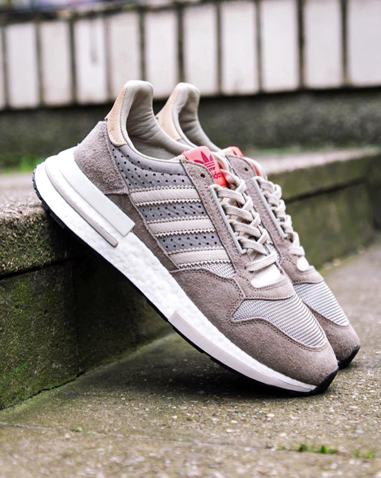 A pair of adidas ZX 500 in beige and red laying in a step. fb44061d6